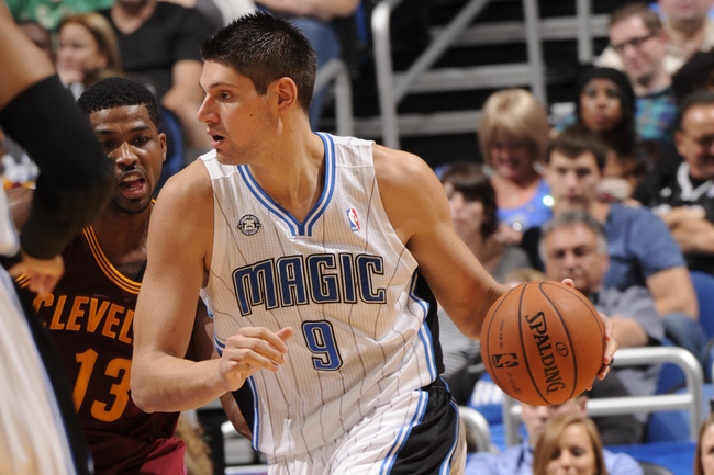 Hi-res-184192017-nikola-vucevic-of-the-orlando-magic-dribbles-the-ball_crop_650