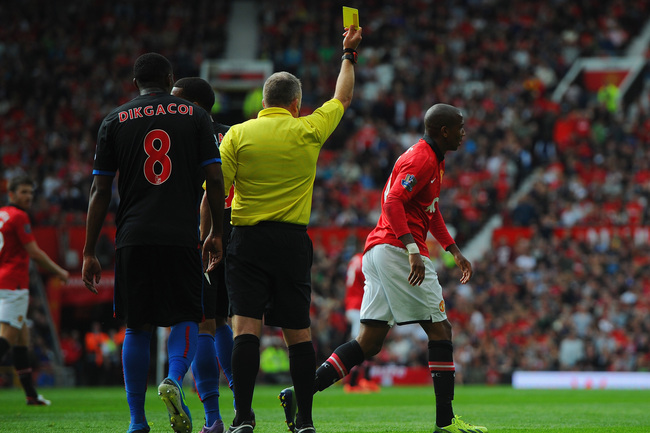 Hi-res-180572930-ashley-young-of-manchester-united-is-booked-by-referee_crop_650