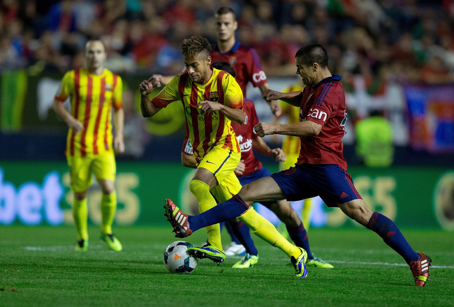Hi-res-185355057-neymar-jr-of-fc-barcelona-competes-for-the-ball-with_crop_650x440
