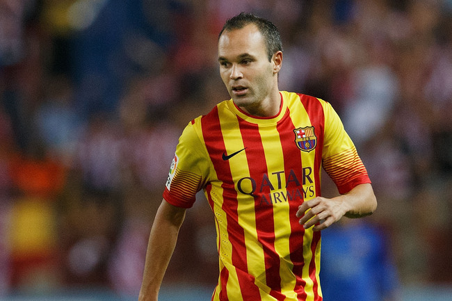 MADRID, SPAIN - AUGUST 21: Andres Iniesta of FC Barcelona controls the ball during the Spanish Super Cup first leg match between Club Atletico de Madrid and FC Barcelona at Vicente Calderon Stadium on August 21, 2013 in Madrid, Spain.  (Photo by Gonzalo A