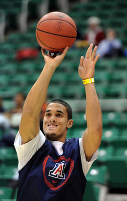 Nick Johnson is the only Arizona returner who substantially shot from beyond the arc last season