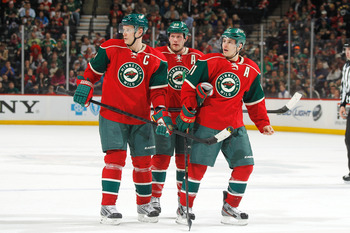 Hi-res-165114608-mikko-koivu-ryan-suter-and-zach-parise-of-the-minnesota_display_image