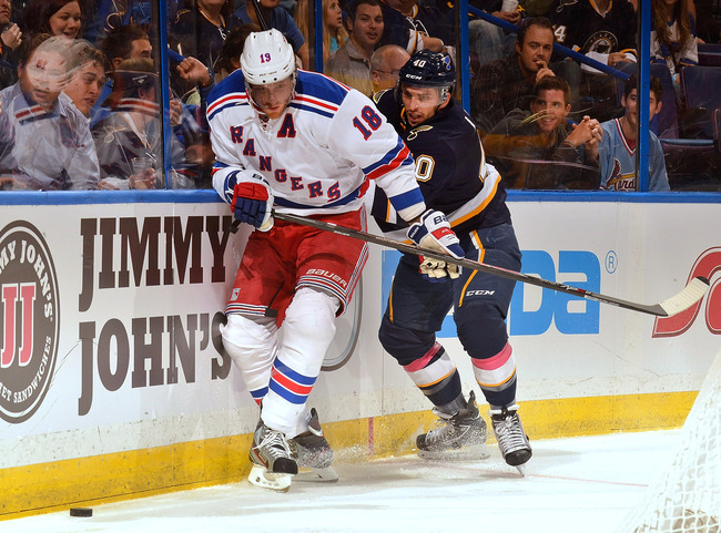 Hi-res-184245352-marc-staal-of-the-new-york-rangers-battles-for-the-puck_crop_650
