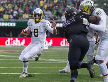Hi-res-184240465-quarterback-marcus-mariota-of-the-oregon-ducks-rushes_display_image
