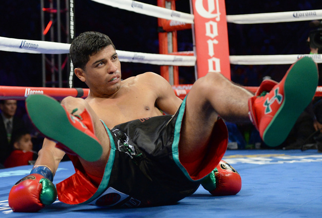 Hi-res-177611521-abner-mares-reacts-after-he-is-knocked-down-by-jhonny_crop_650x440