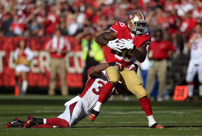 Hi-res-184425154-vernon-davis-of-the-san-francisco-49ers-gets-tackled-by_crop_650