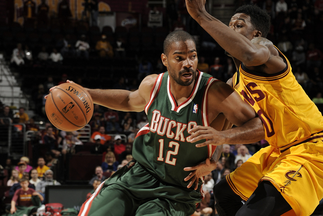 Hi-res-183662331-gary-neal-of-the-milwaukee-bucks-drives-to-the-basket_crop_650