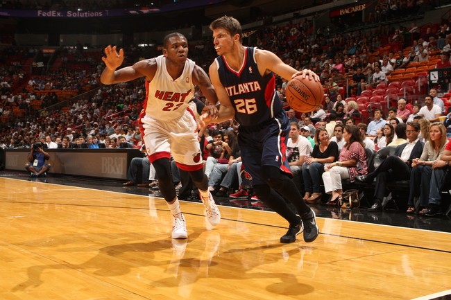 Hi-res-183605958-kyle-korver-of-the-atlanta-hawks-dribbles-baseline_crop_650