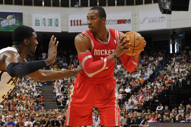 Hi-res-184273614-dwight-howard-of-the-houston-rockets-looks-to-drive-to_crop_650
