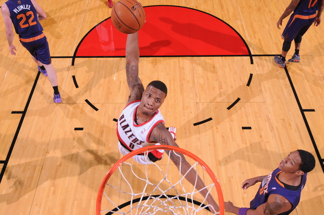 Hi-res-183896075-damian-lillard-of-the-portland-trail-blazers-dunks_crop_650