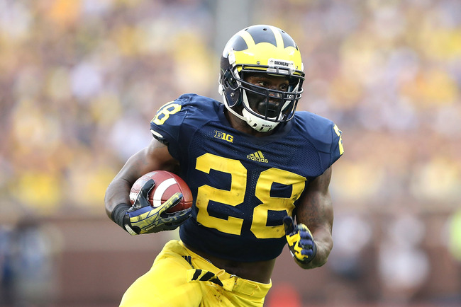 Hi-res-183172522-fitzgerald-toussaint-of-the-michigan-wolverines-runs_crop_650