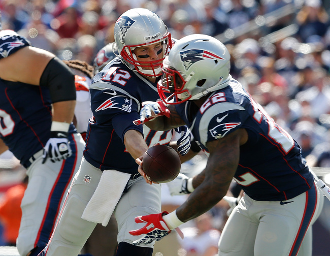 Hi-res-181576760-tom-brady-of-the-new-england-patriots-hands-the-ball-to_crop_650