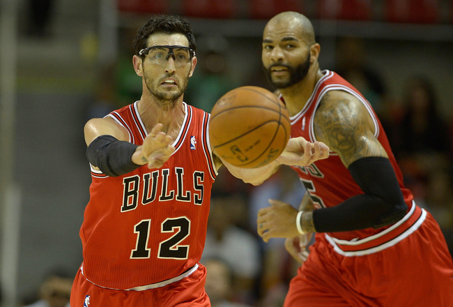 Hi-res-184239974-kirk-hirrich-of-the-chicago-bulls-pass-the-ball-during_crop_650x440