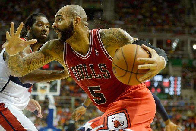 Hi-res-184235144-carlos-boozer-of-the-chicago-bulls-drives-on-nene-of_crop_650