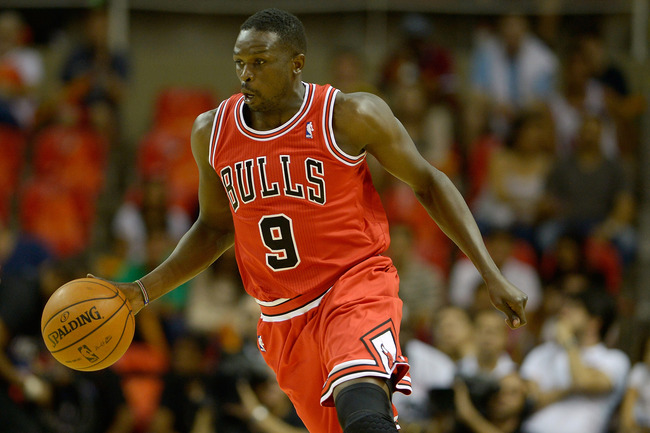 Hi-res-184242265-luol-deng-of-the-chicago-bulls-drives-during-chicago_crop_650