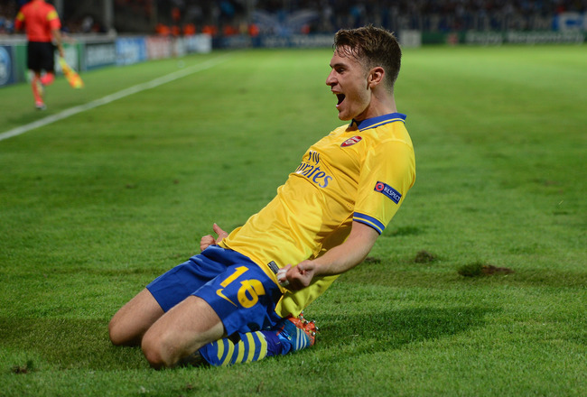 Hi-res-180965551-aaron-ramsey-of-arsenalcelebrates-his-goal-during-the_crop_650x440