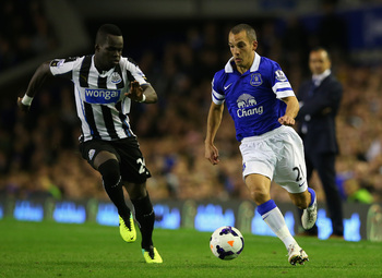 Hi-res-182580837-cheik-tiote-of-newcastle-in-action-with-leon-osman-of_display_image