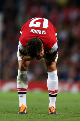Hi-res-182605716-olivier-giroud-of-arsenal-recats-after-a-clash-of-heads_display_image