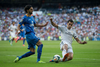 Hi-res-181569531-angel-lafita-of-getafe-cf-competes-for-the-ball-with_display_image