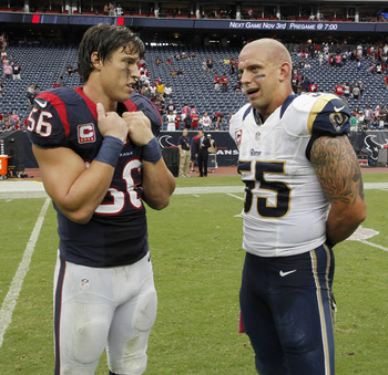 Hi-res-184416415-brian-cushing-of-the-houston-texans-talks-with-james_display_image