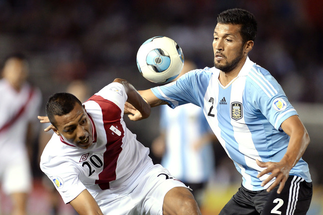 Hi-res-184185204-ezequiel-garay-of-argentina-vies-for-the-ball-with-luis_crop_650