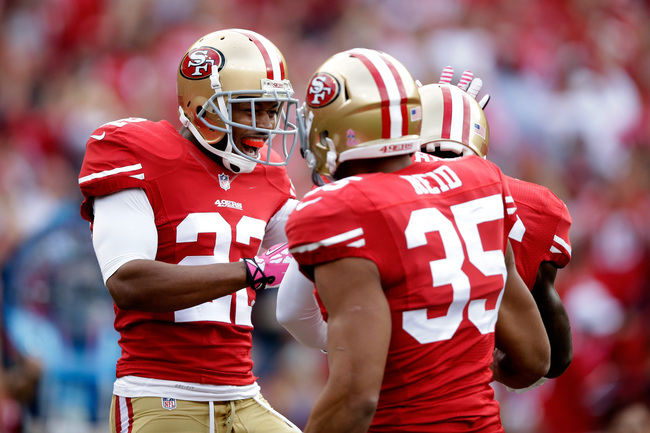 Hi-res-183472296-carlos-rogers-and-eric-reid-celebrate-a-touchdown_crop_650