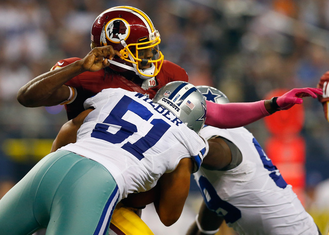 Hi-res-184430516-robert-griffin-iii-of-the-washington-redskins-fumbles_crop_650