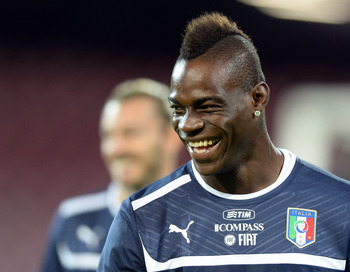 Hi-res-184587993-mario-balotelli-of-italy-smiles-during-a-training_display_image