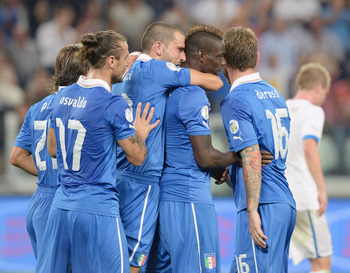 Hi-res-180372780-mario-balotelli-of-italy-celebrates-scoring-the-second_display_image