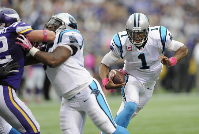 Hi-res-184416457-cam-newton-of-the-carolina-panthers-carries-the-ball_crop_650x440
