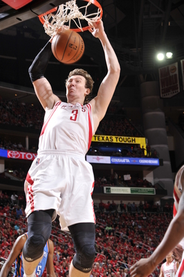 Hi-res-167998846-omer-asik-of-the-houston-rockets-dunks-the-ball-against_display_image