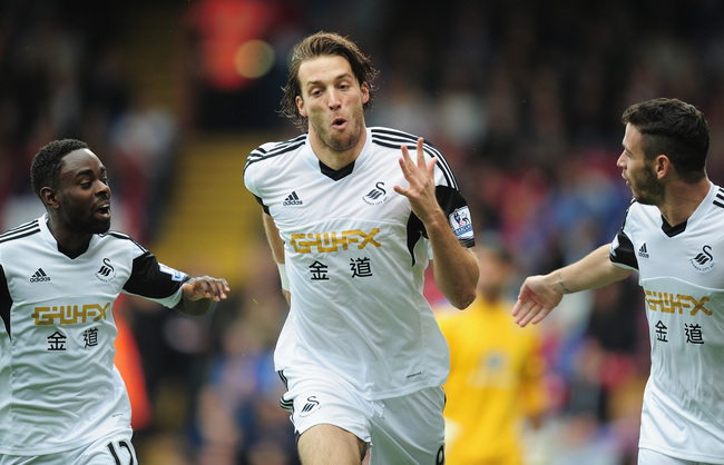 Hi-res-181534306-michu-of-swansea-city-celebtates-his-goal-during-the_crop_650