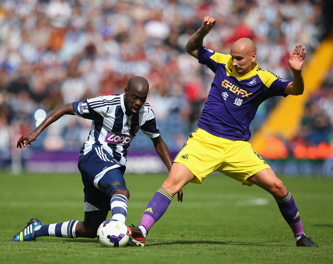 Hi-res-179184245-youssuf-mulumbu-of-west-brom-and-jonjo-shelvey-of_crop_650