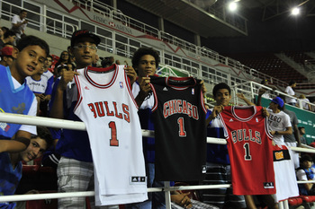 Hi-res-183965283-fans-pose-with-chicago-bulls-jerseys-during-a-special_display_image
