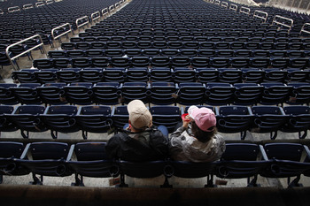 Hi-res-181474291-baseball-fans-eat-ice-cream-in-a-section-of-empty-seats_display_image