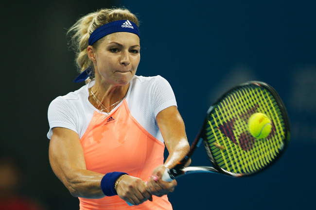 Hi-res-182289696-maria-kirilenko-of-russia-returns-the-ball-to-jie-zheng_crop_650