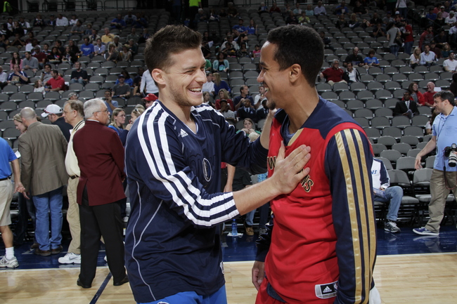 Hi-res-184458767-gal-mekel-of-the-dallas-mavericks-shakes-hands-with_crop_650