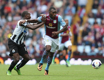 Hi-res-180533936-christian-benteke-of-aston-villa-tangles-with-mapou_display_image