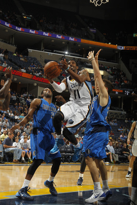 Hi-res-183752732-mike-conley-of-the-memphis-grizzlies-shoots-against_display_image