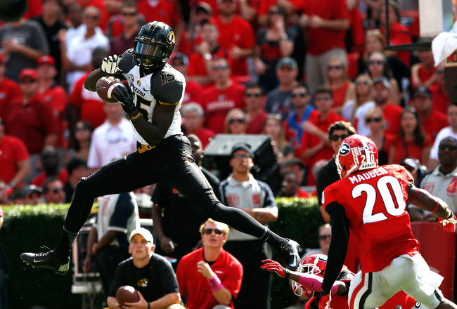 Hi-res-184230624-dorial-green-beckham-of-the-missouri-tigers-pulls-in_crop_650x440