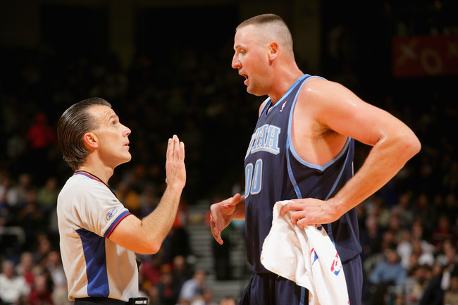 Hi-res-56135678-referee-ken-mauer-discusses-a-call-with-greg-ostertag-of_crop_650