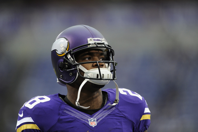 Hi-res-184407323-adrian-peterson-of-the-minnesota-vikings-looks-on_crop_650