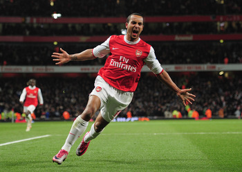 Hi-res-107790644-theo-walcott-of-arsenal-celebrates-arsenals-third-goal_display_image