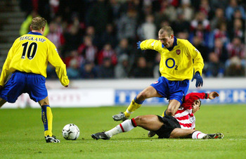 Hi-res-2835935-fredrik-ljungberg-of-arsenal-is-tackled-during-the-fa_display_image
