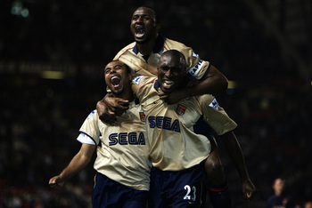 Hi-res-613957-ashley-cole-patrick-vieira-and-sol-campbell-of-arsenal_display_image