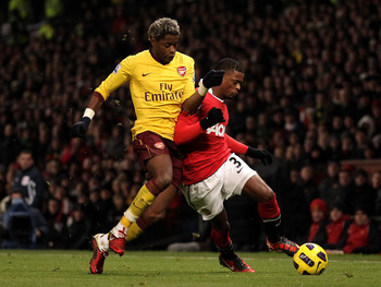 Hi-res-107559640-patrice-evra-of-manchester-united-battles-for-the-ball_display_image