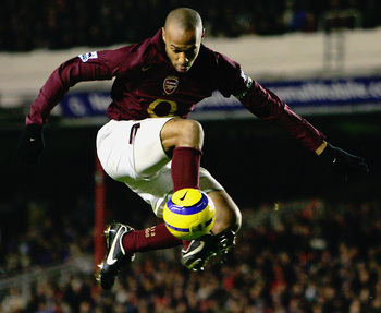 Hi-res-56505707-thierry-henry-of-arsenal-controls-the-ball-during-the_display_image