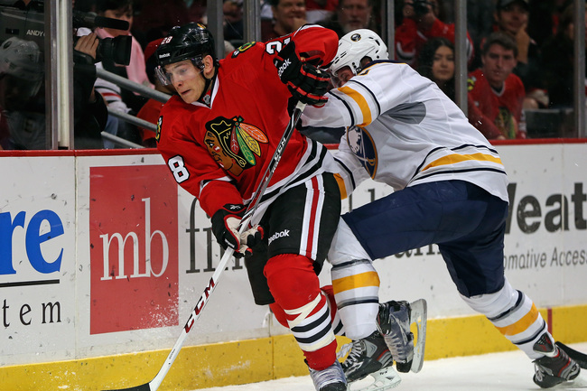 Hi-res-184245463-ben-smith-of-the-chicago-blackhawks-controls-the-puck_crop_650
