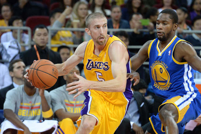 Hi-res-184675817-steve-blake-of-the-los-angeles-lakers-drives-against_crop_650