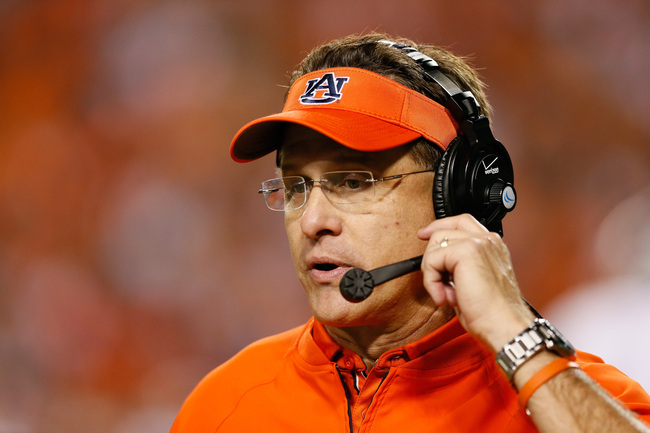 Hi-res-180591352-head-coach-gus-malzahn-of-the-auburn-tigers-looks-on_crop_650
